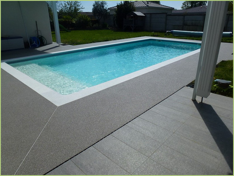 Pool beaches in gray marble aggregates, and clear pool curbs